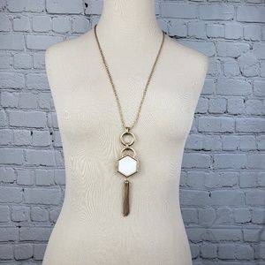 Gold tone pendant necklace